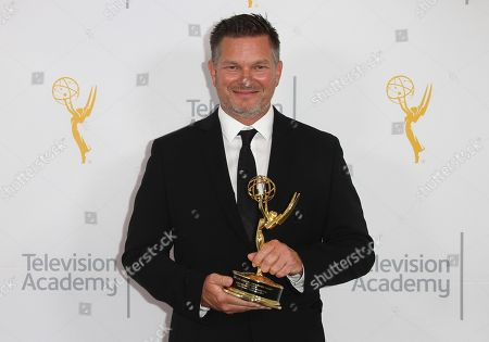 John Hudson, winner of the Emmy for Graphics, poses for a portrait at the L.A. Area Emmy Awards presented at the Television Academy's new Saban Media Center, in the NoHo Arts District in Los Angeles