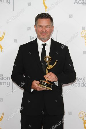 John Hudson, winner of the Emmy for Graphics, poses for a portrait at the L.A. Area Emmy Awards presented at the Television Academyâ?™s new Saban Media Center, in the NoHo Arts District in Los Angeles