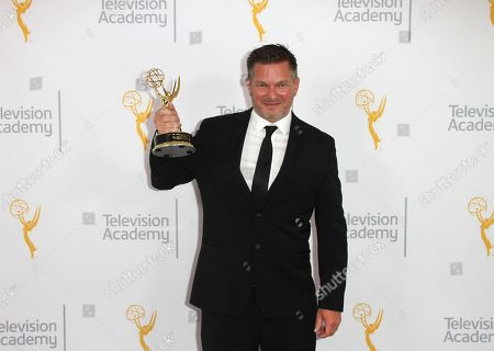 Stock Photo of John Hudson, winner of the Emmy for Graphics, poses for a portrait at the L.A. Area Emmy Awards presented at the Television Academy's new Saban Media Center, in the NoHo Arts District in Los Angeles