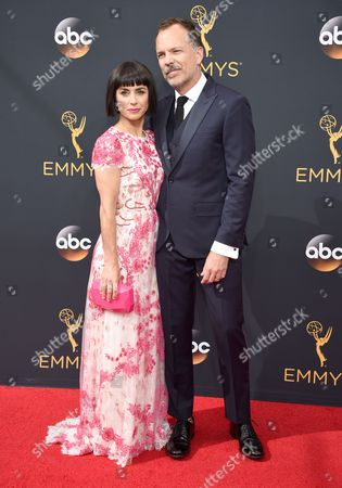 Constance Zimmer, left, and Russ Lamoureux arrive at the 68th Primetime Emmy Awards, at the Microsoft Theater in Los Angeles