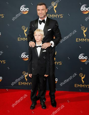Liev Schreiber, back, and Alexander Pete Schreiber arrive at the 68th Primetime Emmy Awards, at the Microsoft Theater in Los Angeles