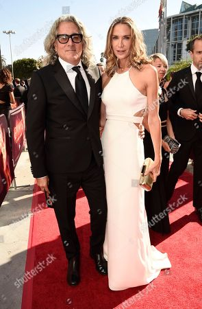 Mitch Glazer, left, and Kelly Lynch arrive at the 68th Primetime Emmy Awards, at the Microsoft Theater in Los Angeles
