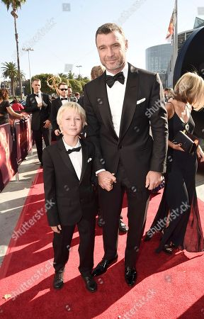 Liev Schreiber, right, and Alexander Pete Schreiber arrive at the 68th Primetime Emmy Awards, at the Microsoft Theater in Los Angeles
