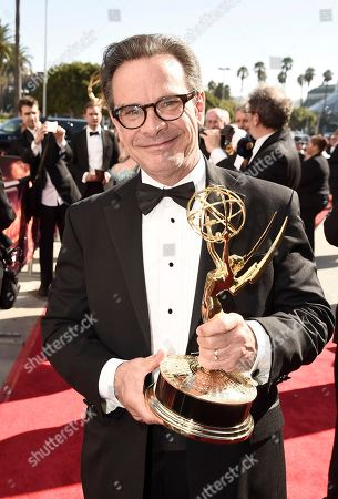 Peter Scolari, winner of the Emmy for Outstanding Guest Actor in a Comedy Series, arrives at the 68th Primetime Emmy Awards, at the Microsoft Theater in Los Angeles