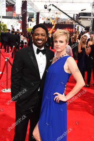 Joe Robert Cole, left, and Polly Cole arrive at the 68th Primetime Emmy Awards, at the Microsoft Theater in Los Angeles