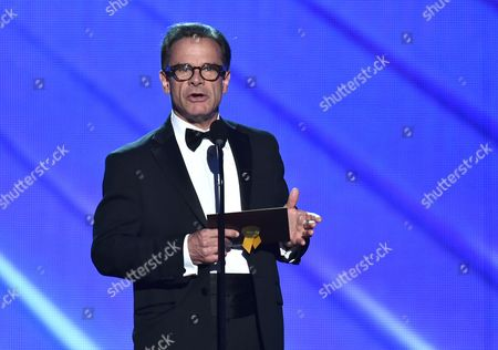 Peter Scolari presents the award for outstanding directing for a comedy series at the 68th Primetime Emmy Awards, at the Microsoft Theater in Los Angeles