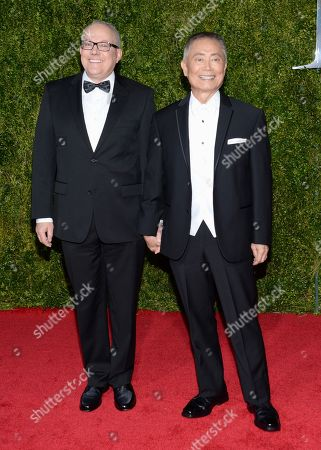 George Takei, right, and Brad Altman arrive at the 69th annual Tony Awards at Radio City Music Hall, in New York
