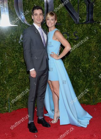 Matt Doyle, left, and Beth Behrs arrive at the 69th annual Tony Awards at Radio City Music Hall, in New York