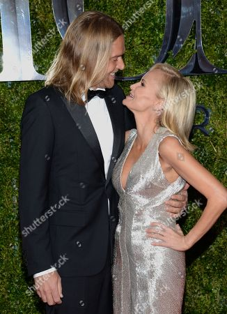 Andrew Pruett, left, and Kristin Chenoweth arrive at the 69th annual Tony Awards at Radio City Music Hall, in New York