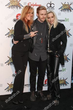 Musician Cherie Currie, right, son Jake Hays, and musician Lita Ford attend the 6th Annual Revolver Golden Gods Award Show at Club Nokia on in Los Angeles, California