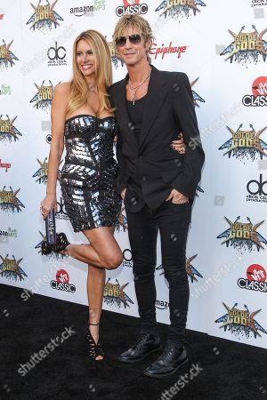 Bassist Duff McKagan of Guns N' Roses and wife Susan Holmes attend the 6th Annual Revolver Golden Gods Award Show at Club Nokia on in Los Angeles, California