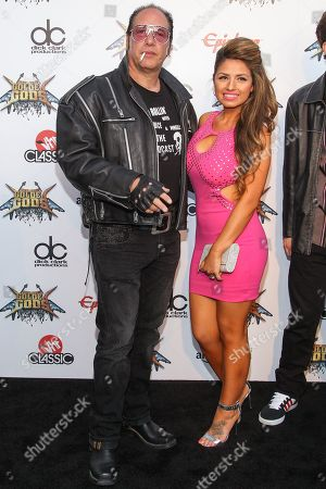 Stock Picture of Comedian Andrew Dice Clay and Valerie Vasquez attend the 6th Annual Revolver Golden Gods Award Show at Club Nokia on in Los Angeles, California