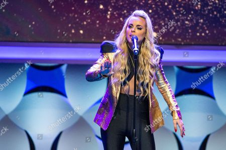 Stock Photo of Katy Tiz performs onstage during the 6th Annual Thirst Gala at The Beverly Hilton Hotel on in Beverly Hills, Calif
