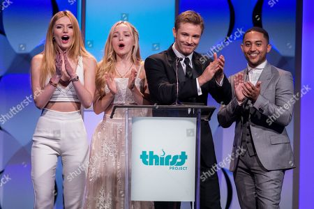 From left, Bella Thorne, Dove Cameron, Michael Welch and Tahj Mowry speak onstage during the 6th Annual Thirst Gala at The Beverly Hilton Hotel on in Beverly Hills, Calif