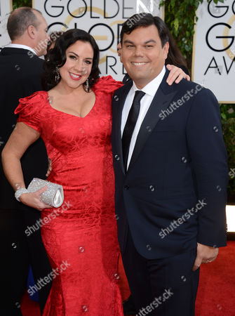 Kristen Anderson-Lopez, left, and Bobby Lopez arrive at the 71st annual Golden Globe Awards at the Beverly Hilton Hotel, in Beverly Hills, Calif