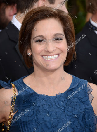 Mary Lou Retton arrives at the 71st annual Golden Globe Awards at the Beverly Hilton Hotel, in Beverly Hills, Calif