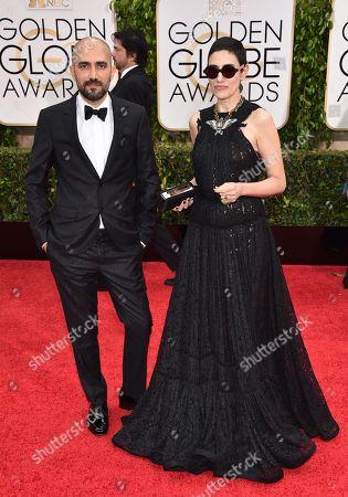 Shlomi Elkabetz, left, and Ronit Elkabetz arrive at the 72nd annual Golden Globe Awards at the Beverly Hilton Hotel, in Beverly Hills, Calif
