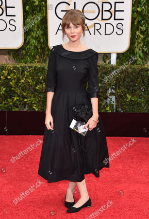 Agata Trzebuchowska arrives at the 72nd annual Golden Globe Awards at the Beverly Hilton Hotel, in Beverly Hills, Calif