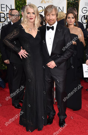Janne Tyldum, left, and Morten Tyldum arrive at the 72nd annual Golden Globe Awards at the Beverly Hilton Hotel, in Beverly Hills, Calif