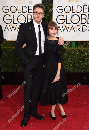 Pawel Pawlikowski, left, and Agata Trzebuchowska arrive at the 72nd annual Golden Globe Awards at the Beverly Hilton Hotel, in Beverly Hills, Calif