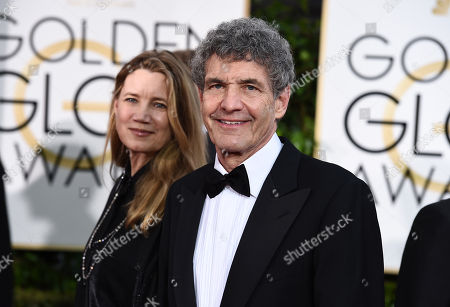 Cindy Horn, left and Alan Horn arrive at the 72nd annual Golden Globe Awards at the Beverly Hilton Hotel, in Beverly Hills, Calif