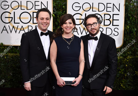 Ido Ostrowsky, from left, Nora Grossman, and Teddy Schwarzman arrive at the 72nd annual Golden Globe Awards at the Beverly Hilton Hotel, in Beverly Hills, Calif