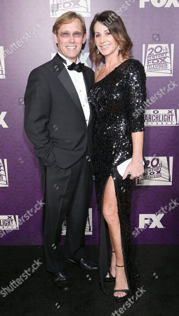 Bart Conner, left, and Nadia Comaneci arrive at the Fox Searchlight Golden Globes afterparty at the Beverly Hilton Hotel, in Beverly Hills, Calif