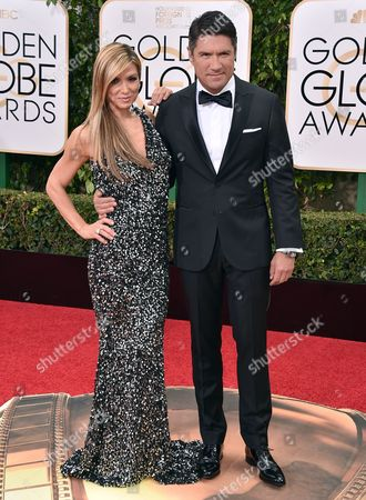 Debbie Matenopoulos, left, and Louis Aguirre arrive at the 73rd annual Golden Globe Awards, at the Beverly Hilton Hotel in Beverly Hills, Calif