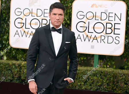 Louis Aguirre arrives at the 73rd annual Golden Globe Awards, at the Beverly Hilton Hotel in Beverly Hills, Calif