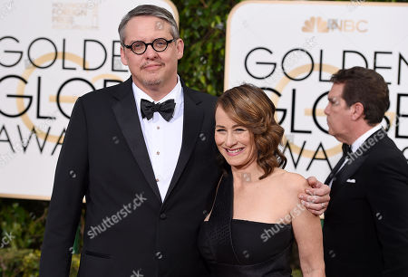 Adam McKay, left, and Shira Piven arrive at the 73rd annual Golden Globe Awards, at the Beverly Hilton Hotel in Beverly Hills, Calif