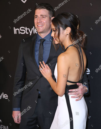 Bryan Greenberg, left, and Jaime Chung arrive at the InStyle and Warner Bros. Golden Globes afterparty at the Beverly Hilton Hotel, in Beverly Hills, Calif