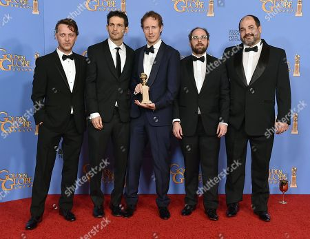 Levente Molnar, from left, Geza Rohrig, Laszlo Nemes, Gabor Sipos, and Gabor Rajna pose in the press room with the award for best motion picture - foreign language for Son of Saul at the 73rd annual Golden Globe Awards, at the Beverly Hilton Hotel in Beverly Hills, Calif