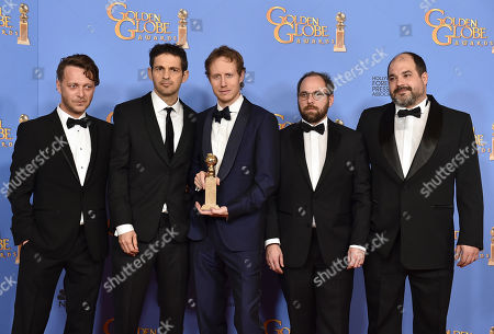Levente Molnar, from left, Geza Rohrig, Laszlo Nemes, Gabor Sipos, and Gabor Rajna pose in the press room with the award for best motion picture - foreign language for â?oeSon of Saulâ?? at the 73rd annual Golden Globe Awards, at the Beverly Hilton Hotel in Beverly Hills, Calif