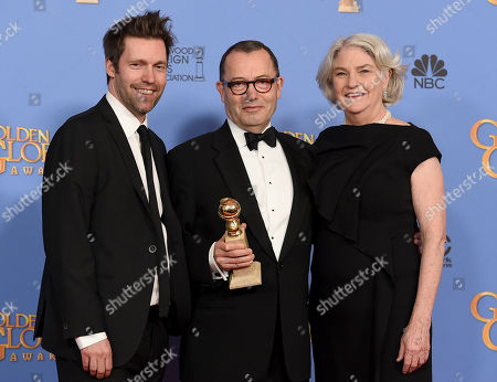 Mark Pybus, from left, Colin Callender, and Rebecca Eaton pose in the press room with the award for best TV limited series - motion picture made for television for â?oeWolf Hallâ?? at the 73rd annual Golden Globe Awards, at the Beverly Hilton Hotel in Beverly Hills, Calif
