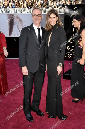 Filmmakers Kirby Dick, left, and Amy Ziering arrive at the 85th Academy Awards at the Dolby Theatre, in Los Angeles