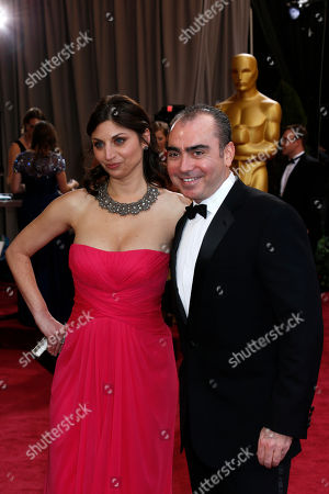 Stock Image of Editor Sari Gilman, left, and producer Jedd Wider arrive at the 85th Academy Awards at the Dolby Theatre, in Los Angeles