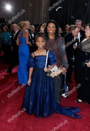 Actress Quvenzhane Wallis, left, and mother Qulyndreia Wallis arrive at the Oscars at the Dolby Theatre, in Los Angeles