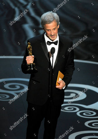 """William Goldenberg accepts the award for best film editing for """"Argo"""" during the Oscars at the Dolby Theatre, in Los Angeles"""