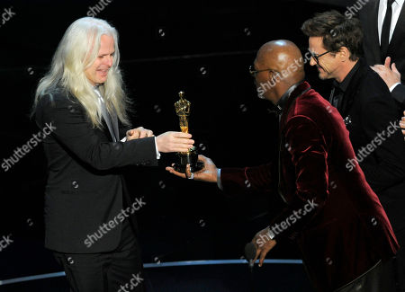 """From right, actors Robert Downey Jr. and Samuel L. Jackson present the award for best cinematography to Claudio Miranda for """"Life of Pi"""" during the Oscars at the Dolby Theatre, in Los Angeles"""
