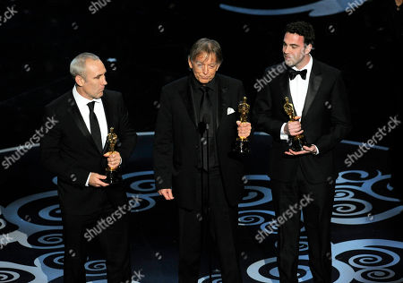 """From left, Simon Hayes, Andy Nelson and Mark Paterson accept the award for best sound mixing for """"Les Miserables"""" during the Oscars at the Dolby Theatre, in Los Angeles"""