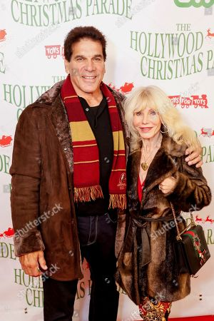 Lou Ferrigno, left, and Carla Ferrigno arrive at the 85th Annual Hollywood Christmas Parade, in Los Angeles