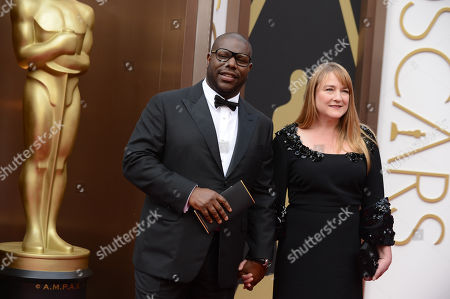 Steve McQueen, left, and Bianca Stigter arrive at the Oscars, at the Dolby Theatre in Los Angeles