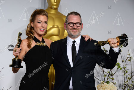 "Caitrin Rogers, left and Morgan Neville pose in the press room with the award for best documentary feature of the year for ""20 Feet from Stardom"" during the Oscars at the Dolby Theatre, in Los Angeles"