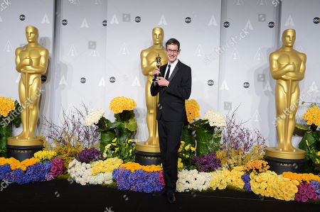 "Steven Price poses in the press room with the award for original score in a feature film for ""Gravity"" during the Oscars at the Dolby Theatre, in Los Angeles"