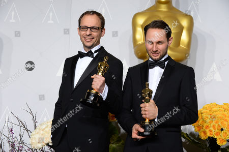 """Laurent Witz, Alexandre Espigares pose in the press room with the award for best animated short film of the year for """"Mr. Hublot"""" during the Oscars at the Dolby Theatre, in Los Angeles"""