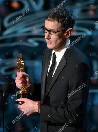 "Steven Price accepts the award for original score in a feature film for ""Gravity"" during the Oscars at the Dolby Theatre, in Los Angeles"