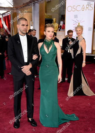 Romain Dauriac, left, and Scarlett Johansson arrive at the Oscars, at the Dolby Theatre in Los Angeles