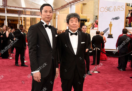 Stock Image of Isao Takahata, left, and Yoshiaki Nishimura arrive at the Oscars, at the Dolby Theatre in Los Angeles