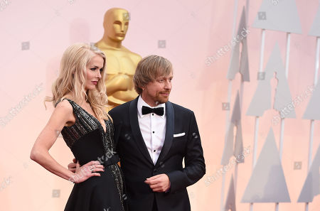 Janne Tyldum, left, and Morten Tyldum arrive at the Oscars, at the Dolby Theatre in Los Angeles