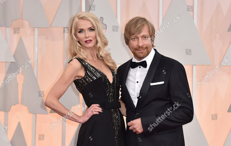 Stock Image of Janne Tyldum, left, and Morten Tyldum arrive at the Oscars, at the Dolby Theatre in Los Angeles